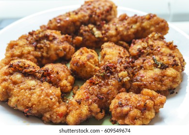 Spicy breaded chicken fingers with red Sichuan chilis and chili oil