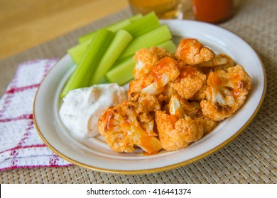 Spicy Buffalo cauliflower bites with dip and celery