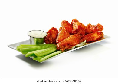 Spicy Buffalo Wings with celery and blue cheese