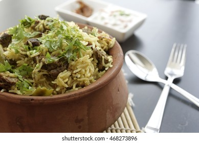 Spicy Camel Biryani Cooked with Parboiled Basmathi Rice, Indian Spices with Garam Masala.