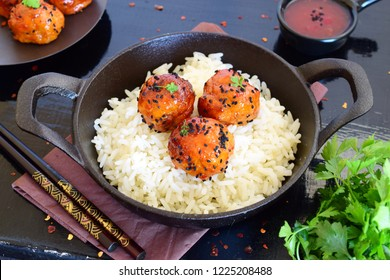 Spicy chicken balls in sweet chilly glazur with rice