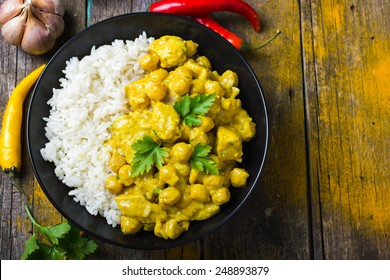 Spicy chicken and chickpeas curry and rice, top view