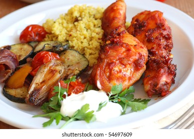 Spicy chicken with couscous and roasted vegetables