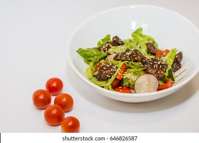 spicy chicken and salad, japanese cuisine.  Asian Fried Chicken and lettuce, tomatoes, radishes, red paprika  and other vegetables. Fresh food, healthy diet concept