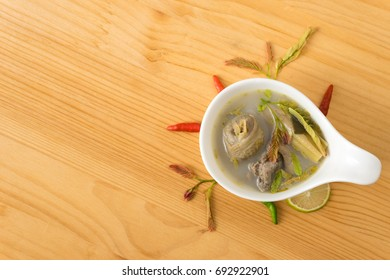 "spicy chicken soup with tamarind leaf and herb in bowl. Thai food name ""Tom Yum Kai"". food for healthy diet"