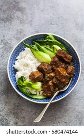 Spicy Chinese braised beef with rice and pak choi