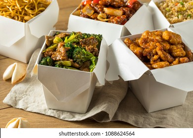 Spicy Chinese Take Out Food with Chopsticks and Fortune Cookies
