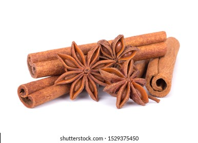Spicy Cinnamon Sticks and Anise isolated on White background closeup macro shot
