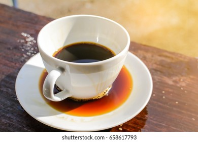Spicy coffee cup clock and news paper on old wooden table nature background the good morning