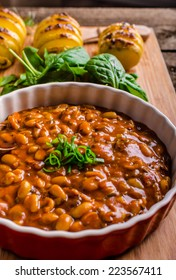 Spicy cowboy beans with chilli, jalapeno, scallions and bacon, Hassleback Potatoe with herbs