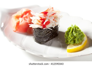 Spicy Crab Meat Gunkan Sushi. Garnished with Ginger and Wasabi