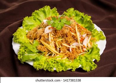 Spicy crispy catfish salad with green mango is a kind of Thai food.
