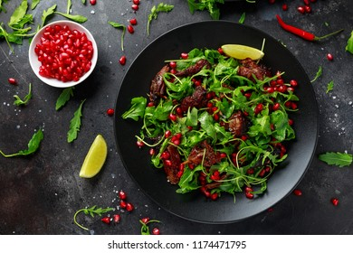 Spicy Crispy Duck salad with pomegranate seeds, lime and wild green rucola.
