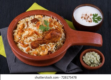 Spicy and delicious chicken biryani in traditional claypot