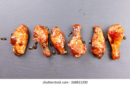 spicy and delicious hot chicken wings in a row