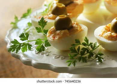 Spicy deviled eggs garnished with green olives