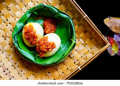 Egg balado images stock photos vectors shutterstock spicy eggs served on banana leaves container with plaited bamboo container in black background captured from thecheapjerseys Image collections