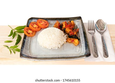 Spicy fish and rice with wood plank on white