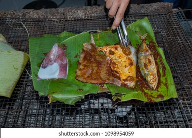 Spicy fishes baked on banana leaf for preparations for breaking fast