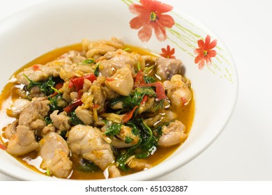 Spicy fried chicken with basil leaves on white background. Thai spicy food, Popular Thai fast food, Thai delicious spicy food, Thai Basil Chicken.