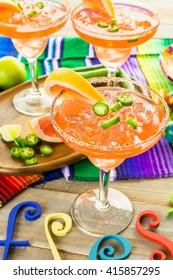 Spicy grapefruit margarita on ice in margarita glasses.