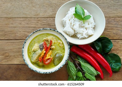 Spicy green curry with chicken serve with noodles , very famous Thai local food.