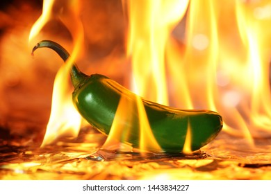 Spicy green Jalapeno pepper on fire