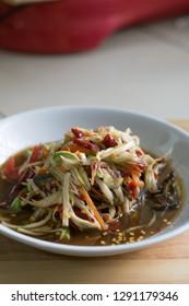 'Som Tum' or Spicy Green Papaya Salad is northeast food of Thailand.
