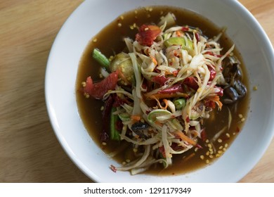 'Som Tum' or Spicy Green Papaya Salad is northeast food of Thailand. top view