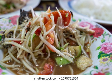 Spicy Green Papaya Salad with pickled fish delicious Thai food Cuisine, Som Tum puu pla ra, close up