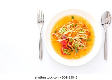 Spicy green papaya salad or somtum isolated on white background with copy space for text, Thai cuisine
