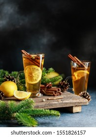 Spicy grog cocktail. Christmas or New Year hot winter drink.  Autumn and winter cocktail - grog, hot sangria, mulled wine with tea, lemon, rome, cinnamon, anise and other spices.