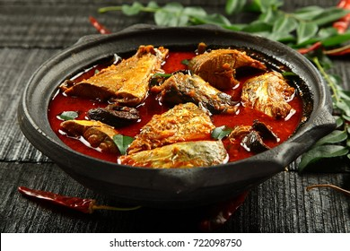 Spicy homemade fish curry in clay pot.