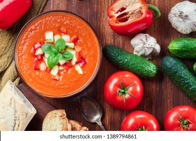 Spicy homemade gazpacho soup served with jamon ham. Traditional spanish dish