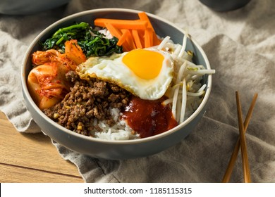 Spicy Homemade Korean Bibimbap Rice with Egg and Beef