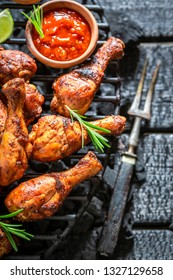 Spicy and hot grilled chicken leg with sauces and lime