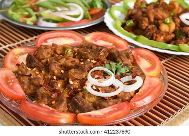 Spicy hot meat curry from Kerala India. beef/buffalo/pork/pig/lamb masala curry. Indian food served with rice, appam popular in Lankan, Thailand, Malaysia, Asian countries. Indian spices, goulash, fry