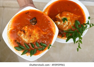 1d2c16a5389 spicy and hot Pomfret fish Curry - female hand holding curry made of  Pomfret fish and