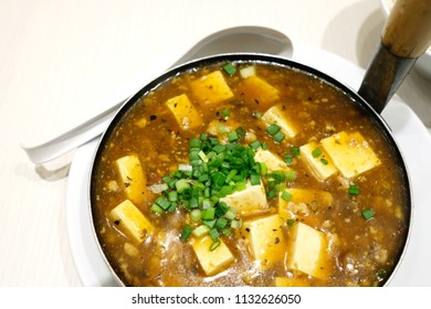 Spicy hot tofu. Mapo doufu or Mapo tofu is a popular Chinese dish from Sichuan province. It consists of tofu set in a spicy sauce, typically a thin, oily, and bright red suspension.