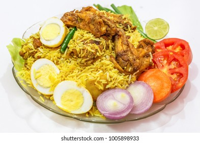 Spicy Indian chicken biriyani rice with sliced eggs and garnished with vegetables. Biriyani is a popular dish in India.