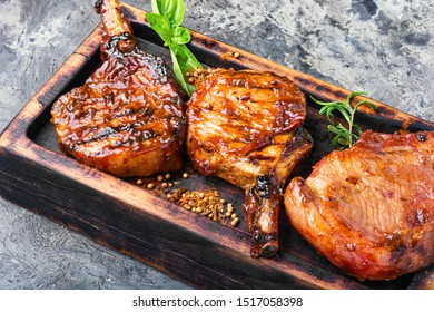 Spicy meat grilled spare ribs on wooden cutting board.Pork rack grilled