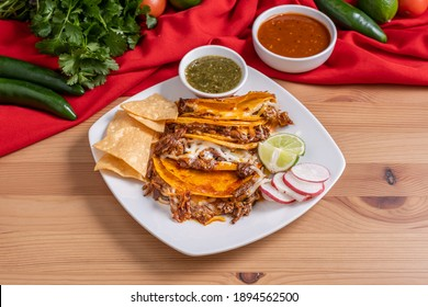 Spicy and messy Mexican birria tacos made with beef. Authentic street tacos. Griddle fried Mexican food.