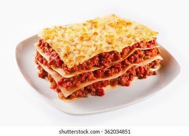 Spicy minced or ground beef lasagne with sheets of traditional Italian noodles alternating with tasty meat served on a plate isolated on white