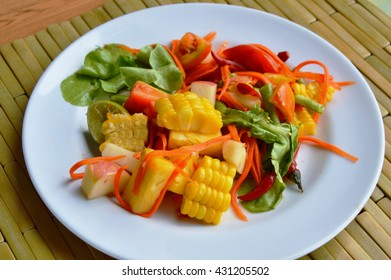 spicy mixed fruit and vegetable salad on dish