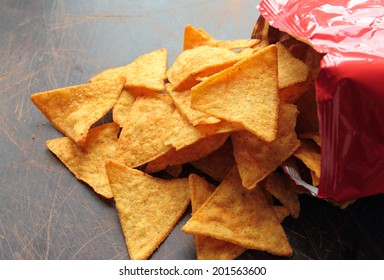 Spicy nachos chips on a wooden table