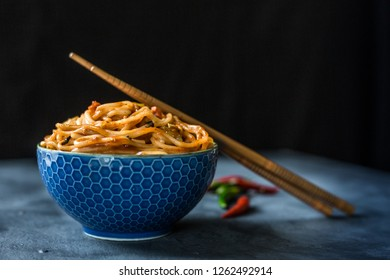 Spicy noodles in a blue bowl