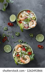 Spicy noodles and shrimp in a bow with peppers