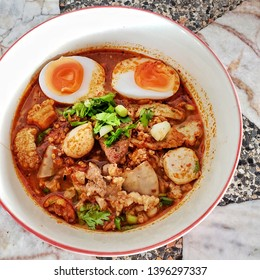 Spicy noodles soup with eggs,  pork balls,  liver, and pork stuff, wit Thai traditional ingredients, In Thailand this soup called 'Tomyum noodles soup
