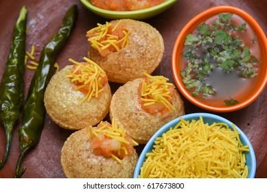 Spicy Pani puri golgappe with potato stuffing, Chat item, India. panipuri, North Indian street food snack served with tangy tamarind water, chaat masala, chickpeas Delhi, Mumbai, Rajasthan, Bangalore