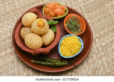 Spicy Pani puri golgappe and  potato stuffing, Chat item, India. panipuri, North Indian street food snack served with tangy tamarind water, chaat masala, chickpeas Delhi, Mumbai, Rajasthan, Bangalore